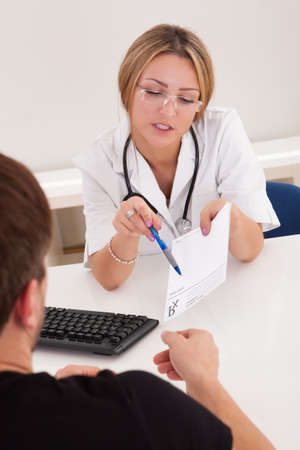 Doctor in clinic explains prescription for sick client. Stock Photo - 16522170