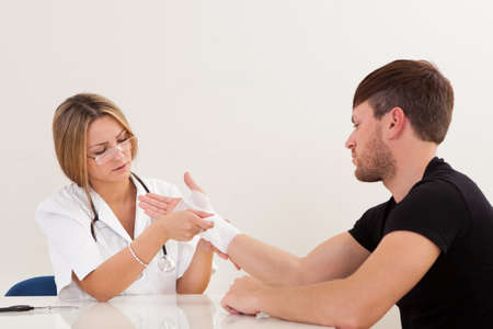 Sprained right hand treated by trained person. Stock Photo - 16522172