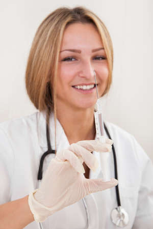 Nurse making injection to patient in clinic Stock Photo - 16522309