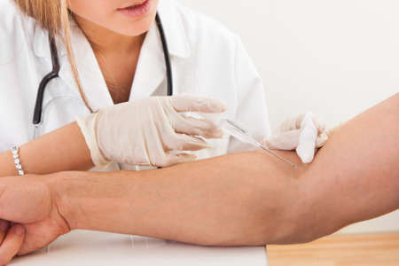 Nurse making injection to patient in clinic Stock Photo - 16522317