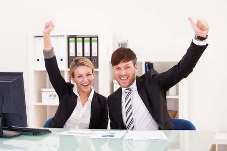 reached: Target sales reached so executives very happy about it. Stock Photo
