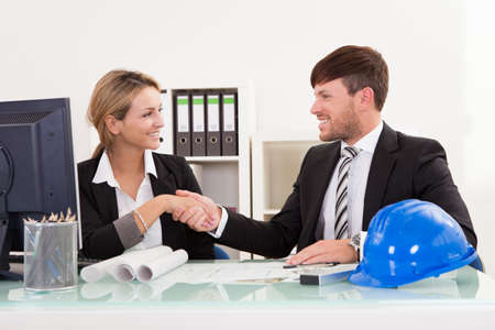Architects shaking hands in the office after reaching agreement photo