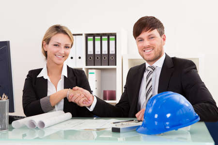 Architects shaking hands in the office after reaching agreement Stock Photo - 16522230