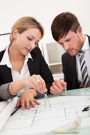 Attractive young architects working on their blueprint Stock Photo - 16522039