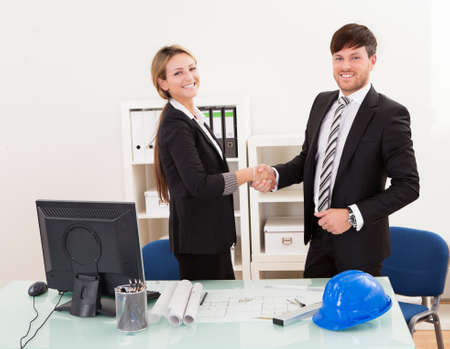 finalized: Architects shaking hands in the office after reaching agreement