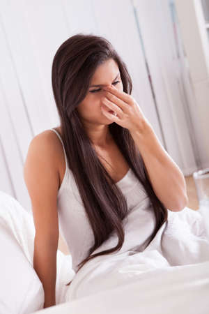 Woman ill in bed with a seasonal cold and flu Stock Photo