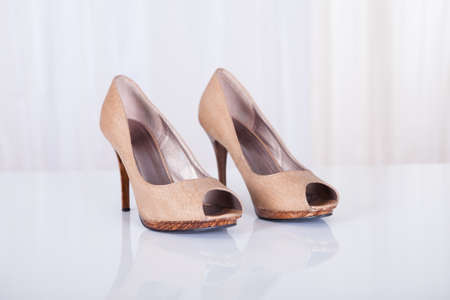 Pair of beige high heeled court shoes over white background Stock Photo - 16548122
