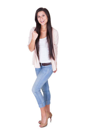 Full length portrait of a young shapely beautiful woman in trendy casual clothing waving her arms in the air isolated on white Stock Photo - 16522667