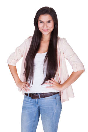 Full length isolated studio portrait of a trendy young woman in casual jeans and stilettos posing in a relaxed stance on white Stock Photo - 16522163