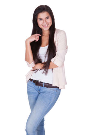 Full length isolated studio portrait of a trendy young woman in casual jeans and stilettos posing in a relaxed stance on white Stock Photo - 16522567