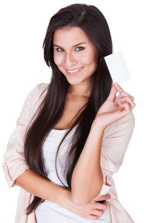 Studio portrait of an attractive brunette woman over white Stock Photo - 16522426