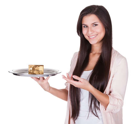 Beautiful charming woman pointing to an metal tray with credit card Stock Photo - 16522597