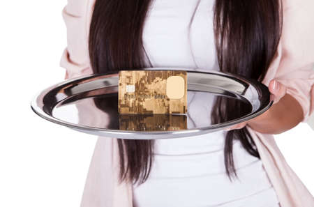 Beautiful charming woman pointing to an metal tray with credit card photo