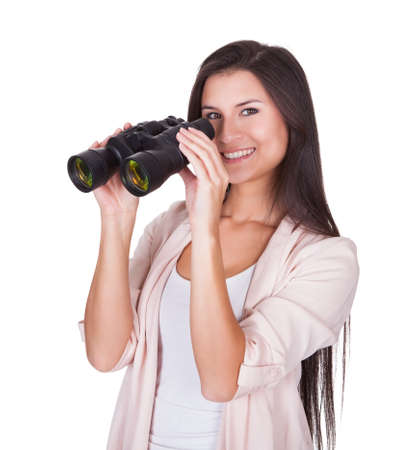 Attractive smiling woman with binoculars isolated on white Stock Photo - 16522445