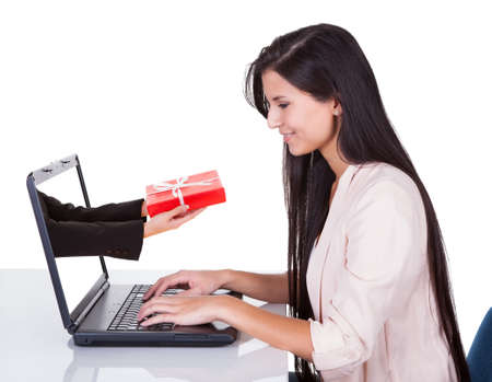 Woman doing online shopping sitting at her laptop photo