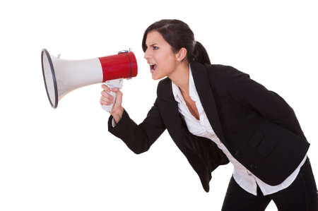 Woman shouts through a megaphone. Studio shot over white Stock Photo - 16522676