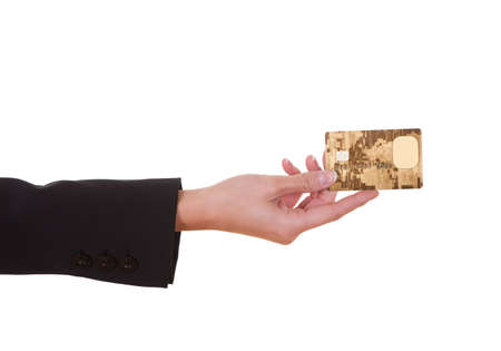 cropped out: Woman holding out a credit card. Close cropped shot over white
