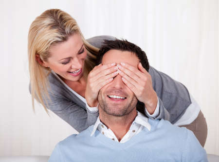 eyes closing: Affectionate couple relaxing on a sofa at home Stock Photo