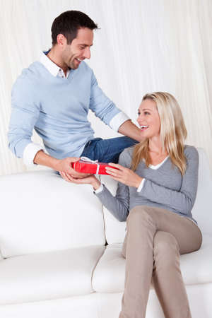 Man giving his wife a surprise gift at home Stock Photo - 16874286