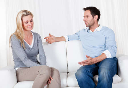 marital: Couple who have fallen out over a disagreement sitting on a sofa Stock Photo