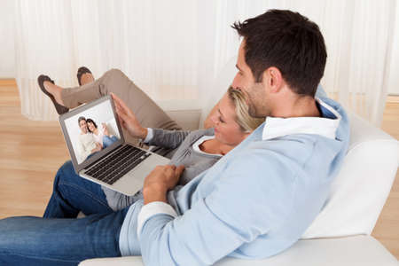 online conference: Loving couple having online video conference at home Stock Photo