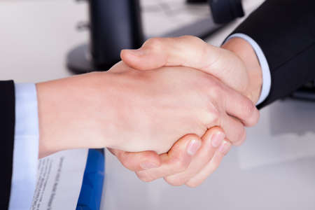 Business handshake over the deal. Close-up on hands photo