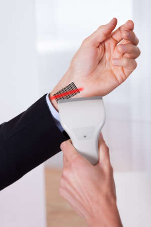 Scanning barcode on the hand using scanner Stock Photo - 16886403