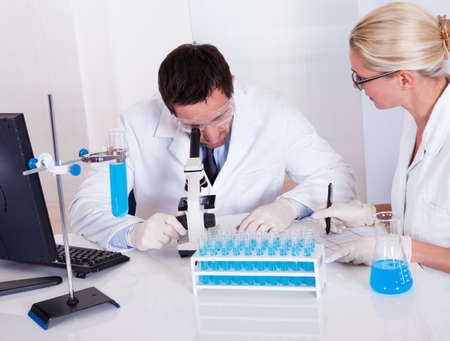 technologist: Two technologists at work in a laboratory Stock Photo