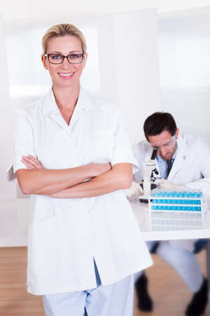Two lab technicians at work in a laboratory Stock Photo - 16874365