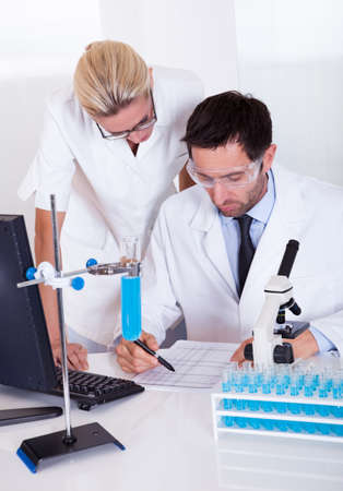 Two lab technicians at work in a laboratory Stock Photo - 16874311