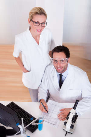 technologist: Two lab technicians at work in a laboratory