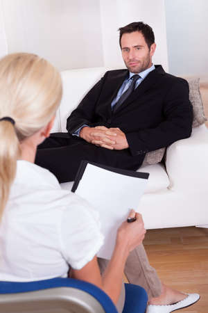 neurosis: A middle aged smart male executive interviewing a young female executive.