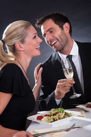 Romantic couple sitting having dinner in an elegant restaurant photo