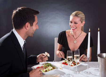 romantic evening with wine: Romantic couple sitting having dinner in an elegant restaurant