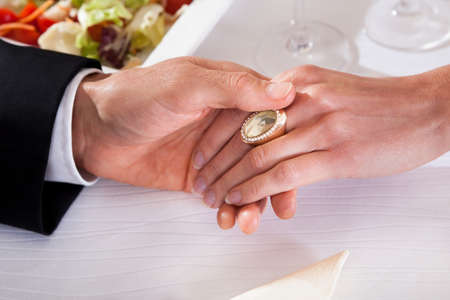 wine and dine: Cropped view image of a man and woman holding hands while enjoying a romantic dinner Stock Photo