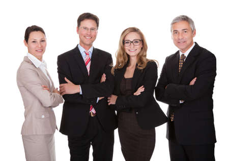 Smiling group of stylish business professionals standing in a row with their arms folded looking at the camera isolated on white photo