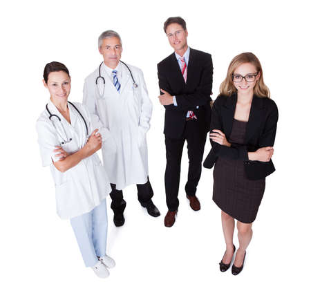 represented: Hospital staff represented by both the medical profession in the form of a doctor and the business administrators Stock Photo