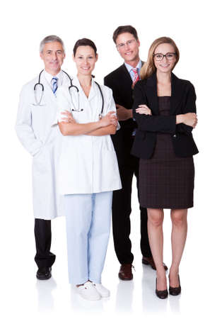 administrative: Hospital staff represented by both the medical profession in the form of a doctor and the business administrators Stock Photo