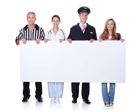 uniformes de oficina: Grupo diverso de personas de la comunidad incluyendo a los profesionales - piloto y médico