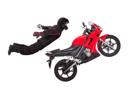 stunts: Young male biker in a helmet doing extreme jump stunt on his red motorcycle isolated on white