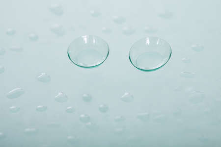 Pair of soft contact lenses lying in a concave position showing the curvature to ensure a close fit on the cornea to correct visual defects Stock Photo - 17277227