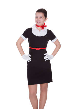 hospitality industry: Pretty young flight attendant or hostess in a smart uniform isolated on white