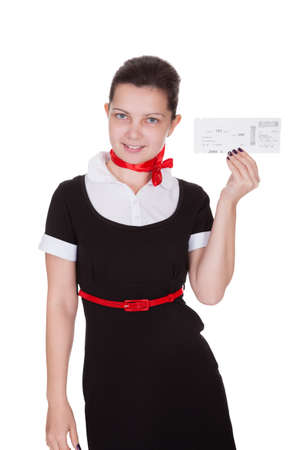 air hostess: Stylish attractive flight attendant holding up an airline ticket in her hand isolated on white Stock Photo