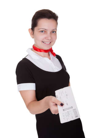 Stylish attractive flight attendant holding up an airline ticket in her hand isolated on white Stock Photo - 17260764