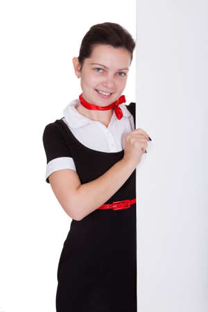 Stewardess holding empty banner. Isolated on white photo