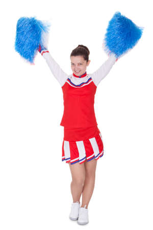Cheerful attractive young teenage cheerleader in her red photo
