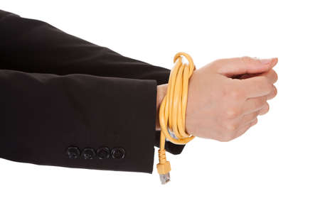 Businessman with hands tied in network cable. Isolated on white photo