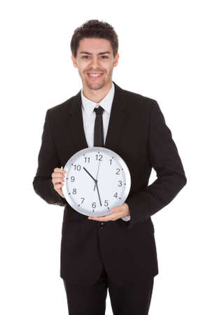 Portrait of businessman with clock. Isolated on white photo