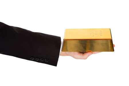 Cropped view of the arm of a businessman holding out a gold bar in a depiction of success and wealth isolated on white photo