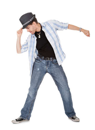 break dance: Young dancer touching his hat and one arm outstretched